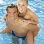 Young couple having fun in pool — Stock Photo #4843937