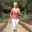 Senior woman running in park — Stock Photo