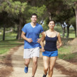 Stok fotoğraf: Couple running in park