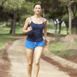 Young woman running in park — Stock Photo
