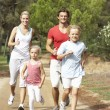 Stock Photo: Family running on path in park