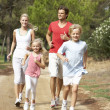 Family running on path in park — Stock Photo