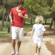 Father and son running in park — Stock Photo #4843980