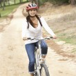 Woman riding bicycle in park — Stock Photo