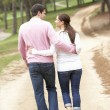 Romantic couple enjoying walk in park - Foto Stock