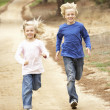 Two Children running in park — Stock Photo