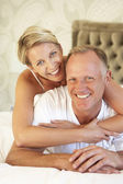 Couple Relaxing In Bedroom — Stock Photo