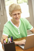 Teenage Boy Using Laptop At Home — Stock Photo