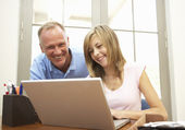 Father And Teenage Daughter Using Laptop At Home — Stock Photo