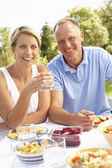 Couple Enjoying Meal In Garden — Stock Photo