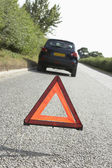 Car Broken Down On Country Road With Hazard Warning Sign In Fore — Stock Photo