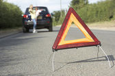 Mother And Daughter Broken Down On Country Road With Hazard Warn — Stock Photo