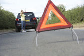 Female Driver Broken Down On Country Road With Hazard Warning Si — Stock Photo