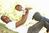 Portrait of Happy Father and Son In Park — Stock Photo