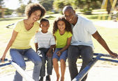 Family In Park Riding On Roundabout — Stock Photo