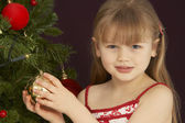 Young Girl Decorating Christmas Tree — Stock Photo