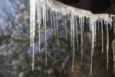 The icicles which are hanging down from a roof at home — Stock Photo