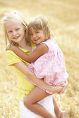 Children Having Fun In Summer Harvested Field — Stock Photo