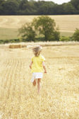 Girl Running Through Summer Harvested Field — Stock Photo