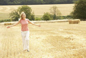 Woman Running Through Summer Harvested Field — Stock Photo