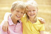 Portrait Of Boy And Girl In Summer Harvested Field — Stock Photo