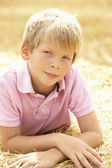 Portrait Of Boy Laying In Summer Harvested Field — Stock Photo