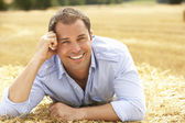 Portrait Of Man Laying In Summer Harvested Field — Stock Photo