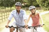 Couple Cycling In Countryside Wearing Safety Helmets — Stock Photo