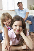 Portrait Of Happy Family Relaxing At Home — Stock Photo