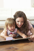Mother And Daughter Learning To Read At Home — Stock Photo