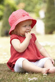 Young Girl Playing In Garden At Home — Foto Stock