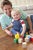 Father And Son Playing With Coloured Blocks At Home — Stock Photo