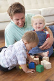 Father And Sons Playing With Coloured Blocks At Home — Stock Photo