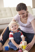 Mother And Son Playing With Coloured Blocks At Home — Stock Photo