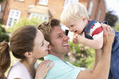 Family Playing Together In Garden At Home — Stock Photo