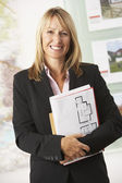 Business woman holding reports — Stock Photo
