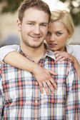 Portrait Of Romantic Young Couple Embracing — Stock Photo
