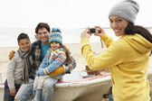 Mother Taking Family Photograph On Winter Beach — Stock Photo