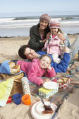 Family Having Picnic On Winter Beach — Stock Photo