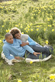 Couple Relaxing In Field Of Spring Daffodils — Stock Photo
