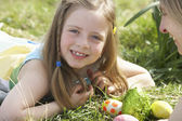 Mother And Daughter On Easter Egg Hunt In Daffodil Field — Photo