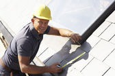Roofer Working On Exterior Of New Home — Stock Photo