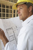 Architect With Plans In New Home — Stock Photo