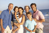 Portrait Of Three Generation Family On Beach Holiday — Stock Photo