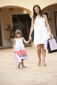 Mother And Daughter Enjoying Shopping Trip Together — Stock Photo