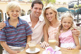 Young Family Enjoying Cup Of Coffee In Caf — Stock Photo
