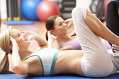 Women Doing Stretching Exercises In Gym — Stock Photo
