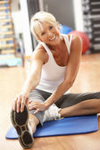 Senior Woman Doing Stretching Exercises In Gym — Stok fotoğraf