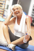 Senior Woman Resting After Exercises In Gym — Stock Photo