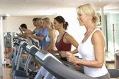 Senior Woman On Running Machine In Gym — Stock Photo